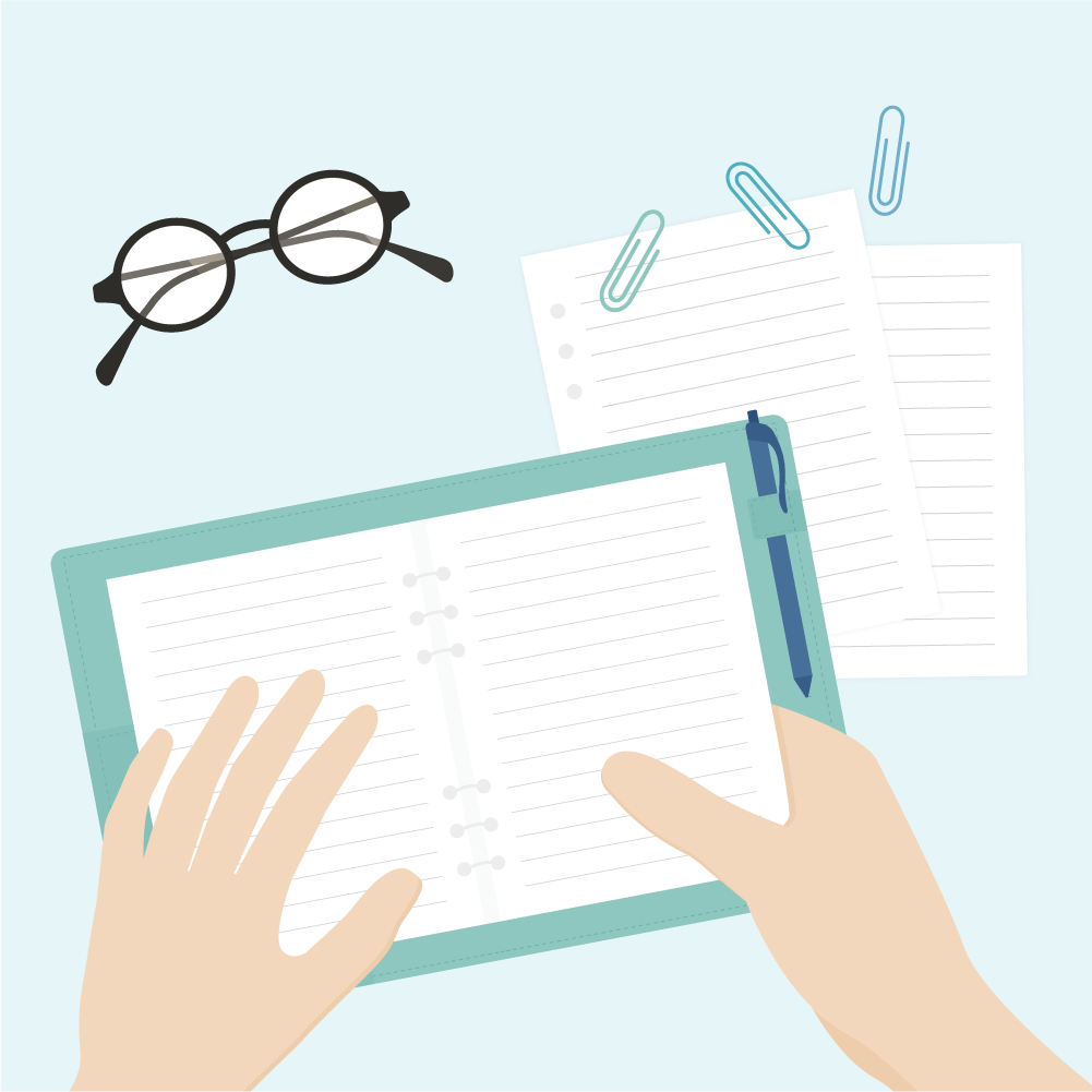 Flat top view illustration of a desk: hands holding a notebook, ballpoint pen, paper clips, loose pages & eyeglasses